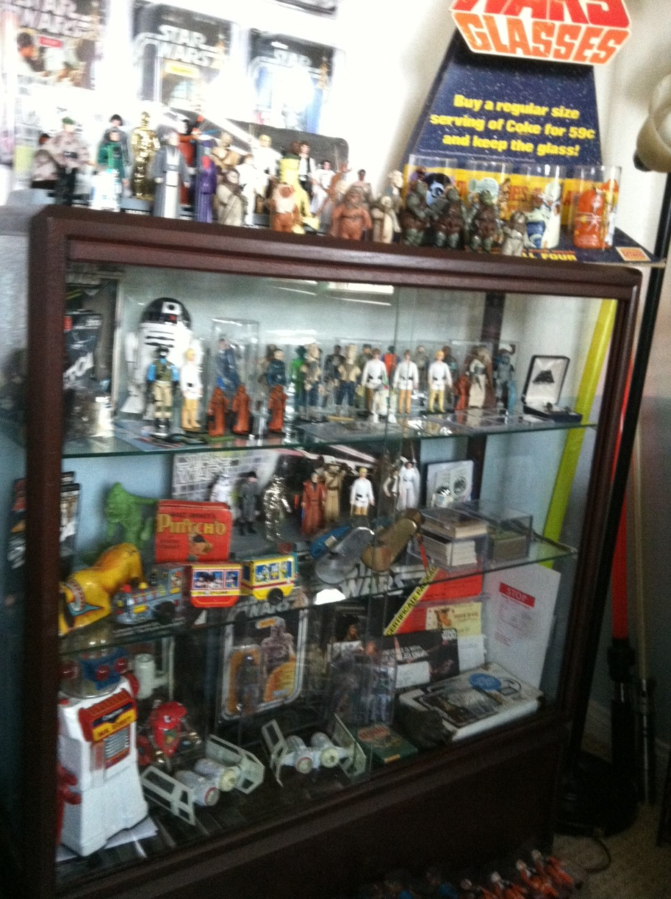 Current set up and still working...Counter Display, 12 backs, and other collectibles Photo110
