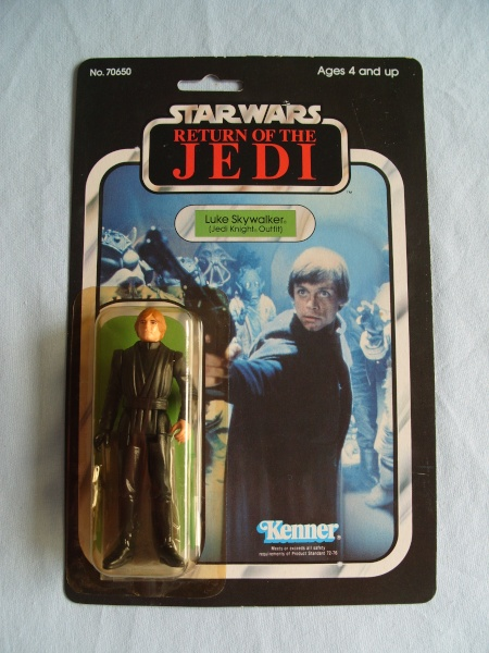 Jedi luke 65 back, green saber with snap cape visable in box. Tj_65-22
