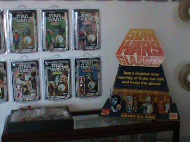 Current set up and still working...Counter Display, 12 backs, and other collectibles Toy_ro12