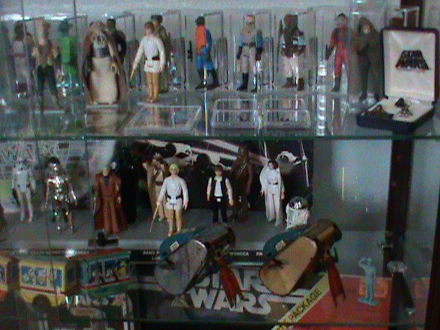 Current set up and still working...Counter Display, 12 backs, and other collectibles Toy_ro17