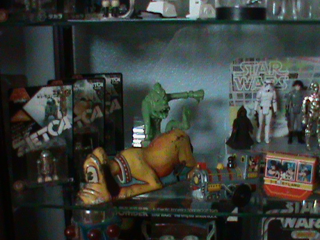 Current set up and still working...Counter Display, 12 backs, and other collectibles Toy_ro19